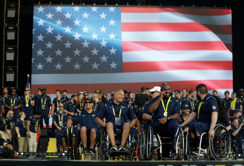 The entire United States team of athletes gather on stage during the closing ceremony at the Invictus Games, Thursday, May 12, 2016, in Kissimmee, Fla. (AP Photo/John Raoux)
